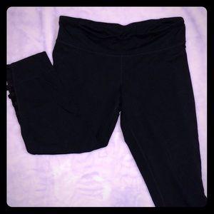 Black Capri length workout pants with leg detail